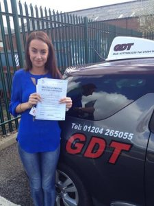 Kayleigh shows off her pass certificate
