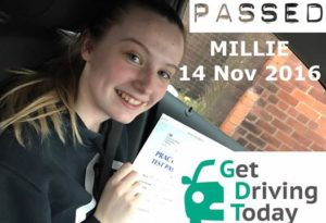 a proud millie displays her test certificate