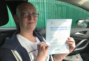 After driving lessons in Bury Lyndsey dispalys her pass certificate
