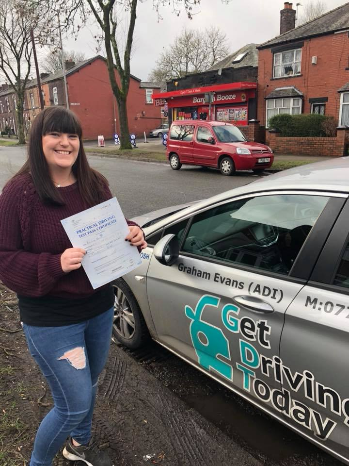 Lucy celedratig after passing her driving test in Bury