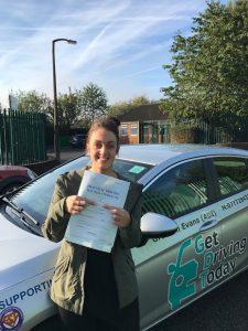 Elisha celebrating her driving test pass