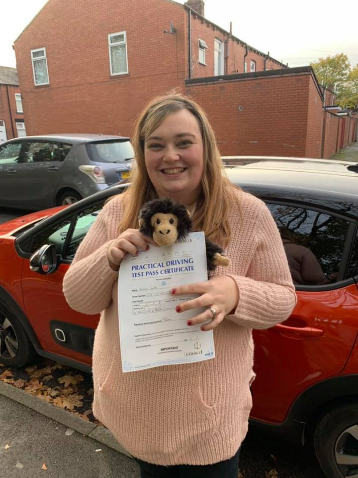 Natalie poses for photograph after passing her driving test in Bury