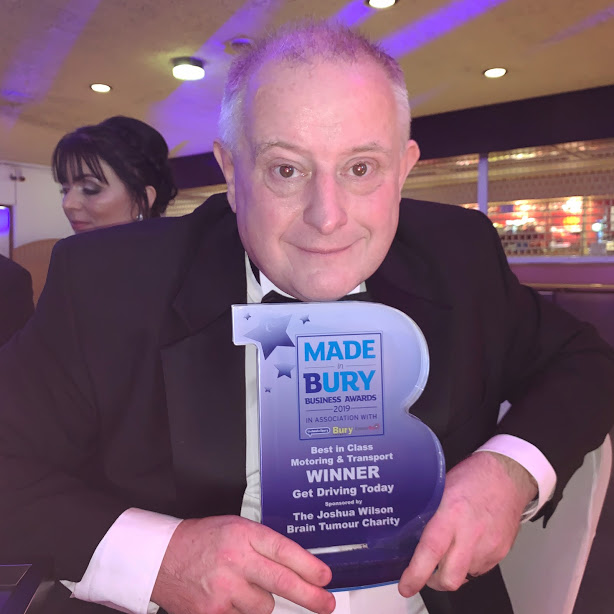 Owner and instructor Graham poses with Made in Bury Business awards trophy